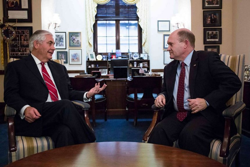 US Senator Chris Coons (right) talks with Rex Tillerson, President-elect Trump's nominee for US Secretary of State, in Capitol Hill, Washington DC, on Jan 4, 2017.