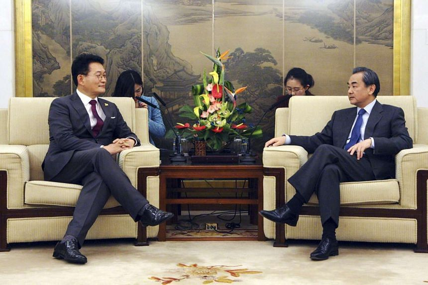 South Korean opposition lawmaker Song Young Gil (left) meeting with Chinese Foreign Minister Wang Yi (right) to discuss the planned deployment of an advanced US anti-missile system, known as Terminal High Altitude Area Defense (Thaad), in Beijing, Ch