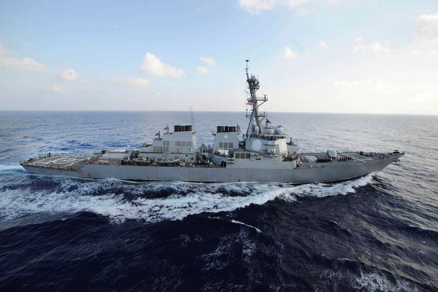 When the Iranian boats did not respond to radio requests by the USS Mahan to slow down, the destroyer fired warning flares.