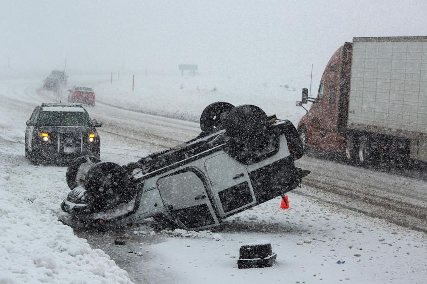 An overturned vehicle is seen on Highway 395 near Mammoth Lakes, California, on January 9, 2017 as a series of strong storms moves through the western US state.