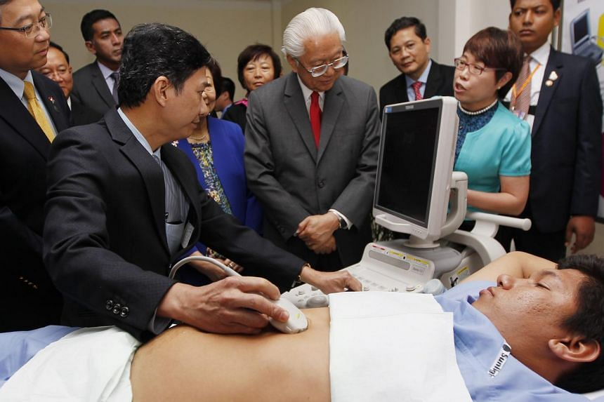 President Tony Tan Keng Yam watches a medical demonstration during a visit to a hospital in Phnom Penh, Cambodia, on Jan 10, 2017.