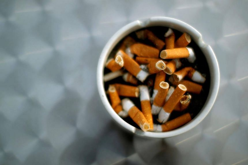 An ash tray with cigarette butts is pictured in Hinzenbach, Austria.