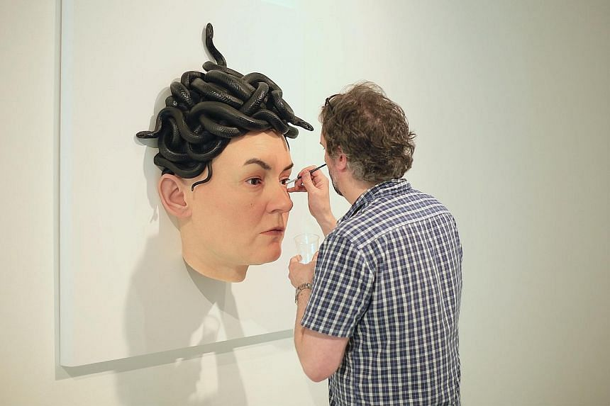 Australian artist Sam Jinks working on his Medusa sculpture, which is modelled after the face of his wife, Emma.