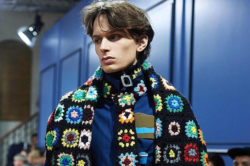 An inescapable feature of modern life, the recognisable motifs of mobile phone applications inspired British designer Jonathan Anderson's London Fashion Week show on Sunday, with his brash embroidered creations lighting up the catwalk. Anderson - who