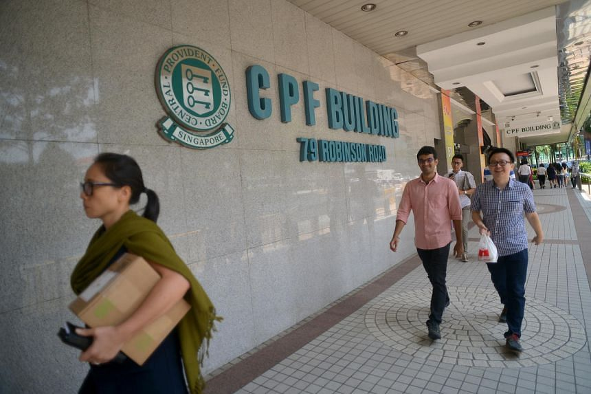 Office workers walking past the CPF building in Robinson Road.