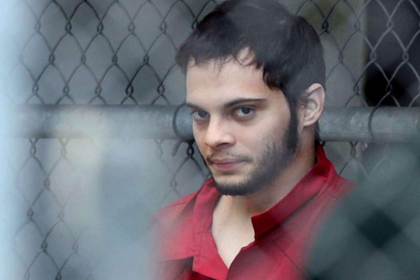 Esteban Santiago is taken from the Broward County main jail as he is transported to the federal courthouse in Fort Lauderdale, on Monday (Jan 9, 2017).