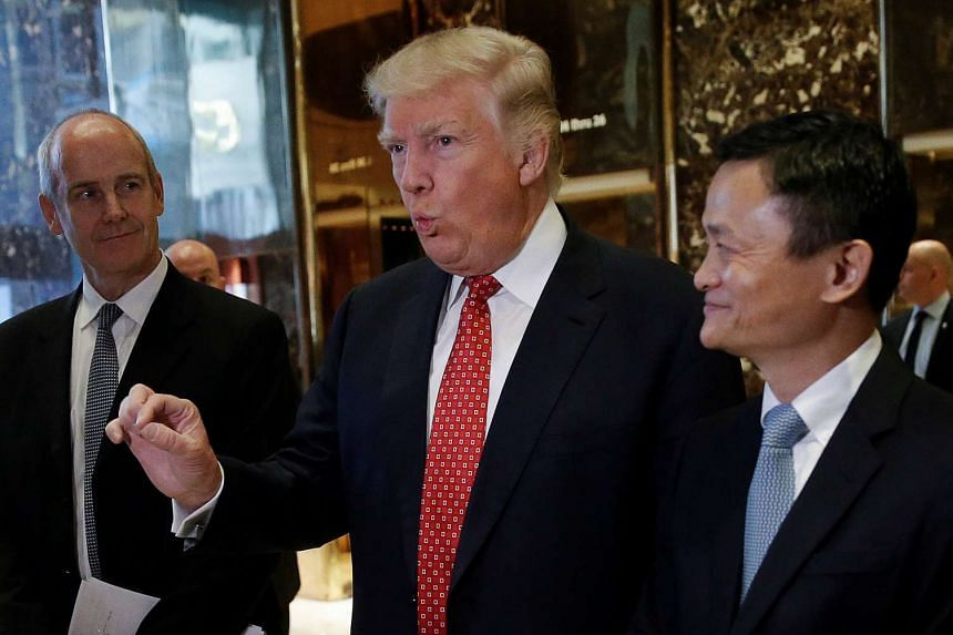 US President-elect Donald Trump and Alibaba's Jack Ma speak with media after their meeting at Trump Tower in New York on Monday (Jan 9, 2017).