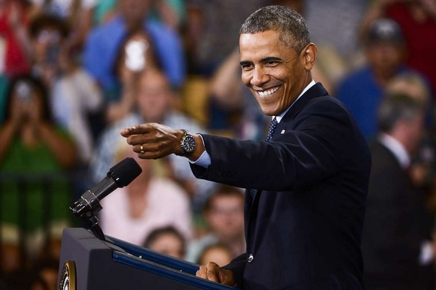 US President Barack Obama as he points to the audience as he arrives to deliver a speech at Knox College in Illinois during his first term in office.