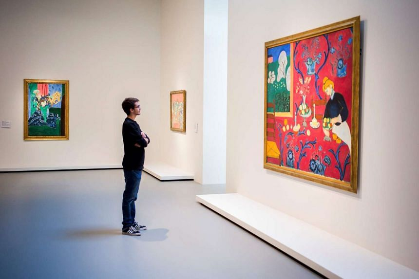 A man looks at a painting of the Russian collector of French modern art Sergei Shchukin - Chtchoukine at the Louis Vuitton foundation.