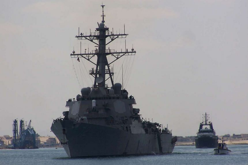 A file photo taken on March 16, 2009 shows guided missile destroyer USS Mahan (centre) crossing the Suez Canal.