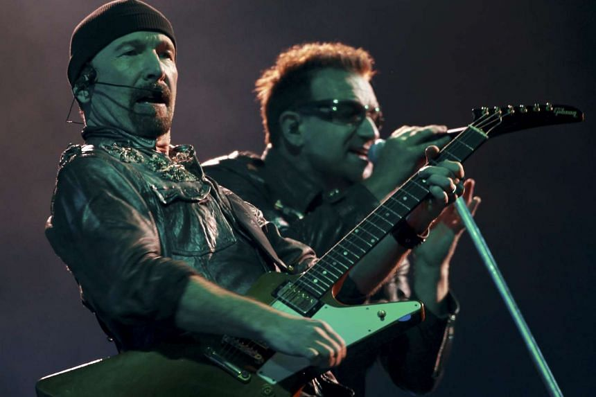 Irish singer Bono (right) and guitarist The Edge perform with their band U2 in Sao Paulo in 2011, as part of their 360 Tour.