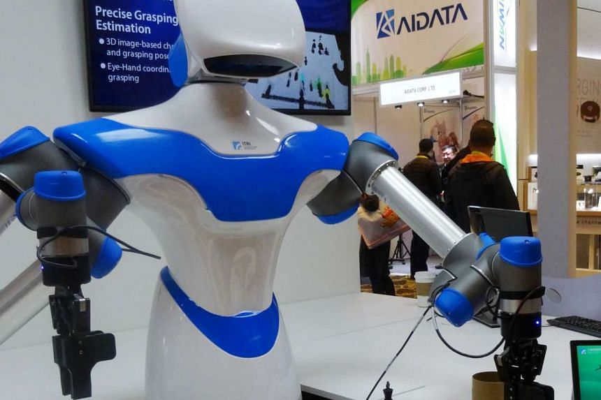 """A robot developed by a Taiwanese institute has been playing games against opponents at the Consumer Electronics Show in Las Vegas. It has an """"intelligent vision system"""" which allows it to see its environment and act with greater precision than it"""