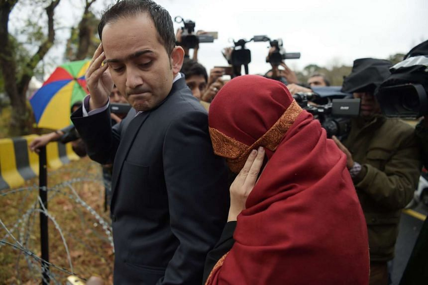 The wife (right) of a Pakistani judge, who with her husband allegedly tortured their 10-year-old maid, leaving the Supreme Court in Islamabad on Jan 6, 2017.