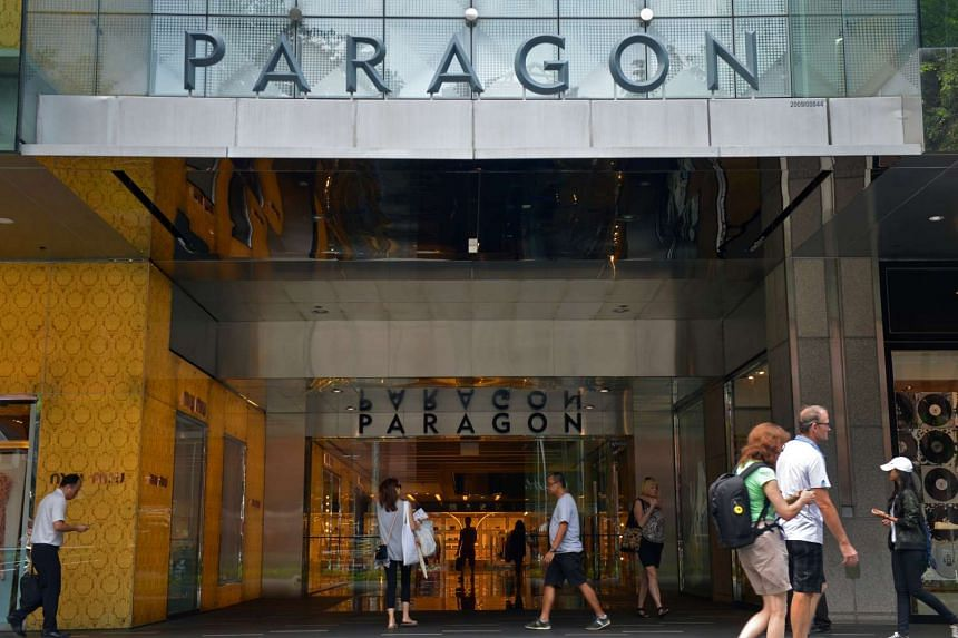 Shoppers at The Paragon shopping mall, one of SPH Reit Management's properties.