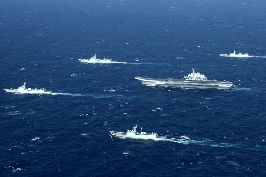 China's Liaoning aircraft carrier and an accompanying fleet conducting a drill in an area of the South China Sea in December 2016.