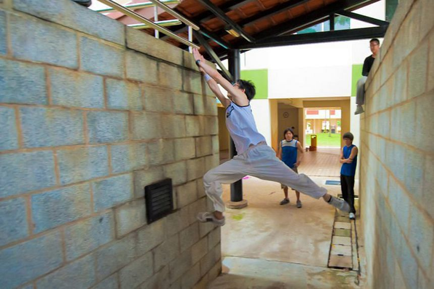A person engaging in Parkour, an urban sport that teaches enthusiasts how to vault over benches, balance on railings and even scale walls.