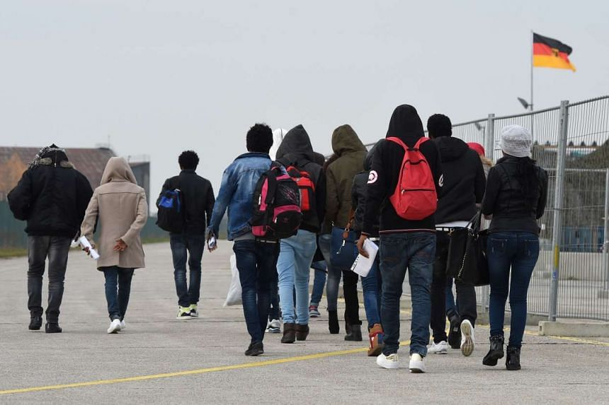 Migrants arrive at the first registration point for asylum seekers in Erding near Munich, southern Germany, on Nov 15, 2016.