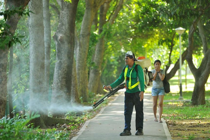 An NEA personnel carrying out misting near Block 101, Aljunied Crescent, on Sept 2, 2016.