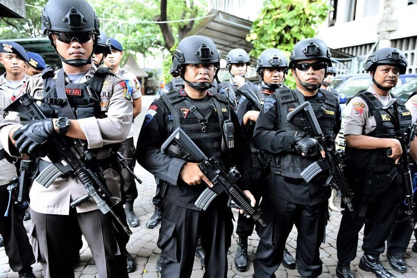 Indonesian police conduct a security preparation at the Jakarta Cathedral on Dec 24, 2016.