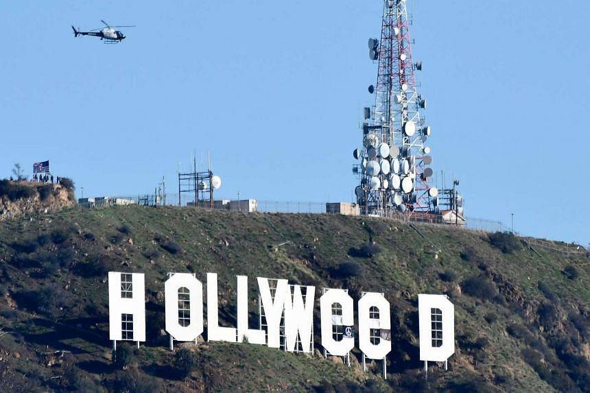 "The famous Hollywood sign reads ""Hollyweed"" after it was vandalised, Jan 1, 2017."