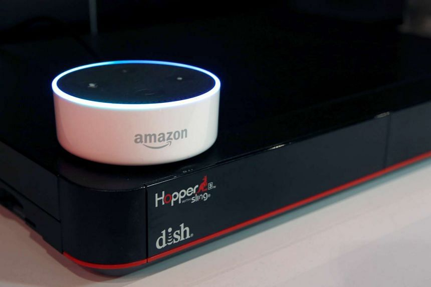 An Amazon Dot is shown on top of a Hopper at the Dish Network booth during the 2017 CES in Las Vegas, Nevada on Jan 6, 2017.