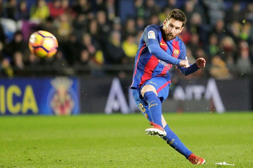 Barcelona's Lionel Messi shoots to score at Ceramic Stadium in Villarreal, Spain on Jan 8, 2016.
