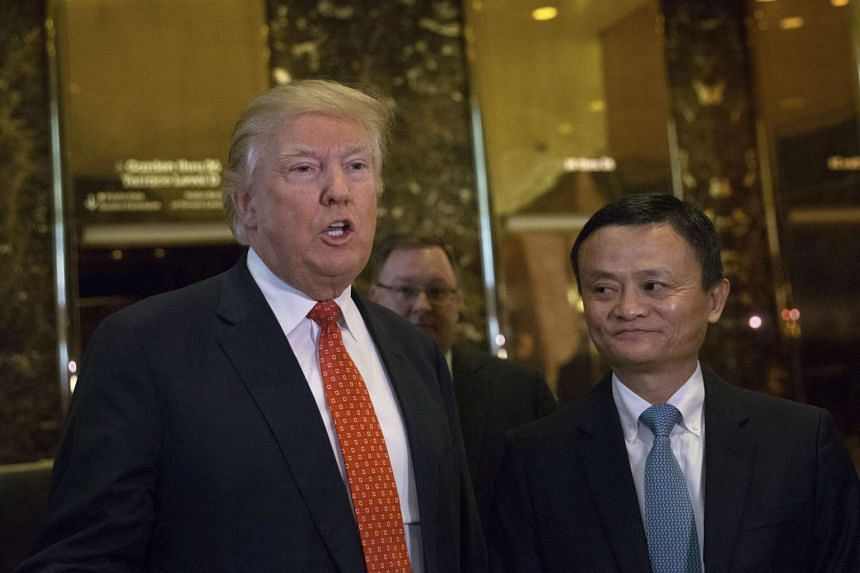 President-elect Donald Trump (left) talks to reporters after emerging from a meeting with Jack Ma, at Trump Tower.