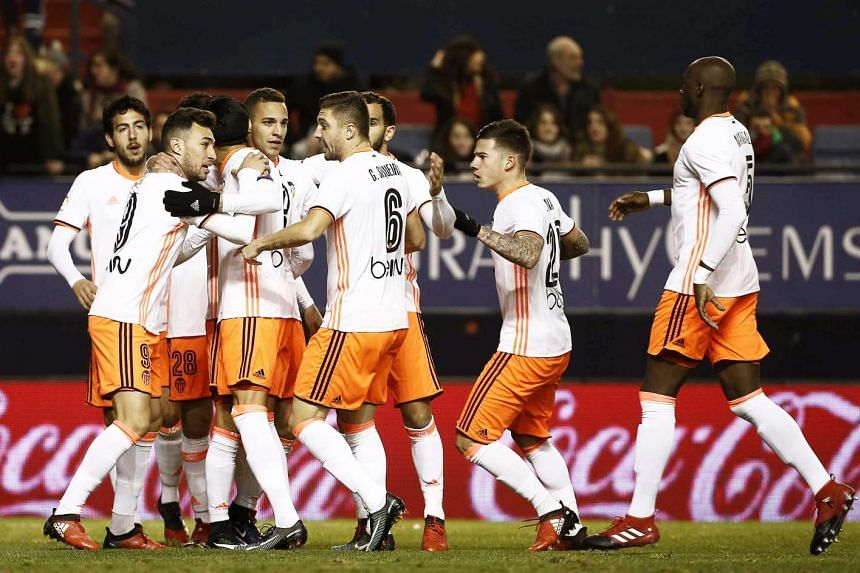 Valencia players celebrating after scoring a goal during the Spanish Primera Division football match between CA Osasuna and Valencia CF on Jan 9, 2017.