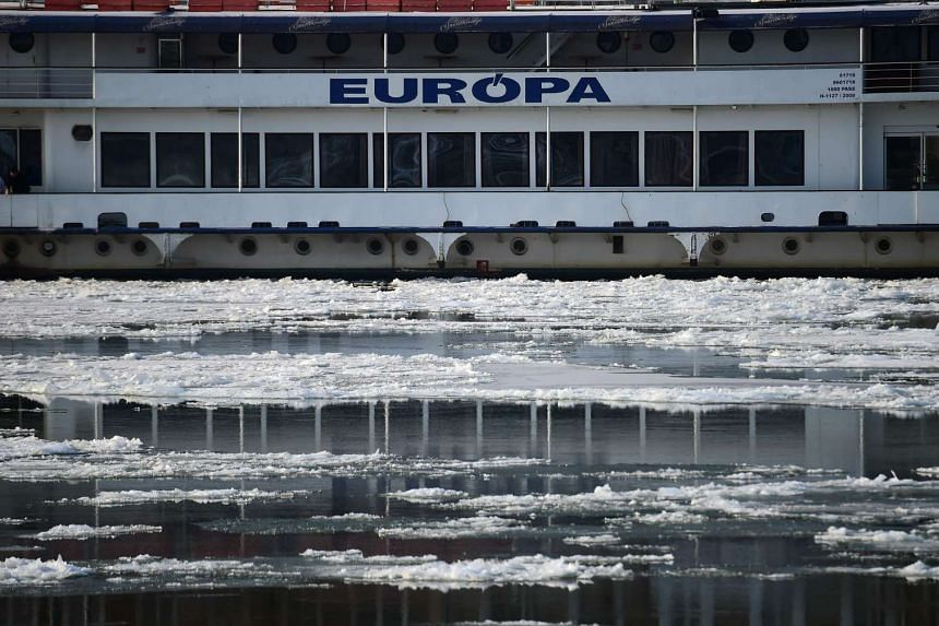 The 'Europa' ship is moored at the Buda side of Budapest downtown as ice floats over the Danube river in Budapest on Jan 10, 2017.