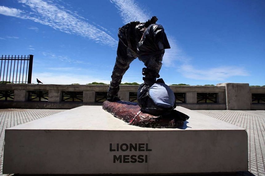 The statue of Argentina's soccer player Lionel Messi is seen covered after it was vandalized in Buenos Aires, Argentina, on Jan 10, 2017.