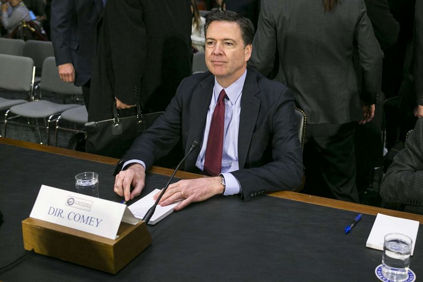 FBI Director James Comey arrives to testify during a hearing about Russian interference in the US presidential election, on Capitol Hill in Washington, Jan 10, 2017.