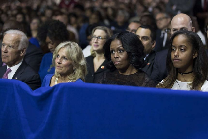 From left: Vice President Joe Biden, Jill Biden, first lady Michelle Obama and Malia Obama listen to President Barack Obama deliver his farewell address at McCormick Place in Chicago on Jan 10, 2017.