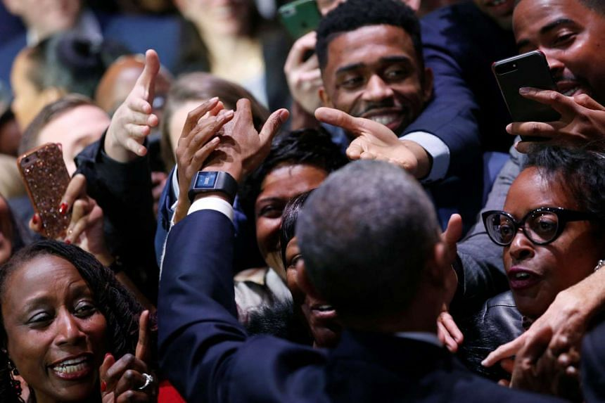 US President Barack Obama greets people in the audience after his farewell address in Chicago, Illinois on Jan 10, 2017.