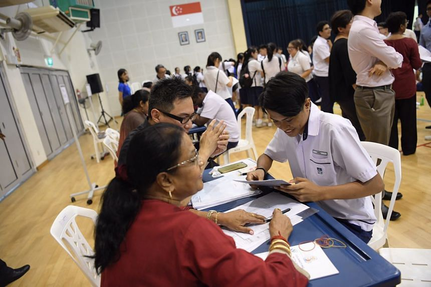 A student receives his O-Level results at Serangoon Garden Secondary School on Jan 11, 2017.