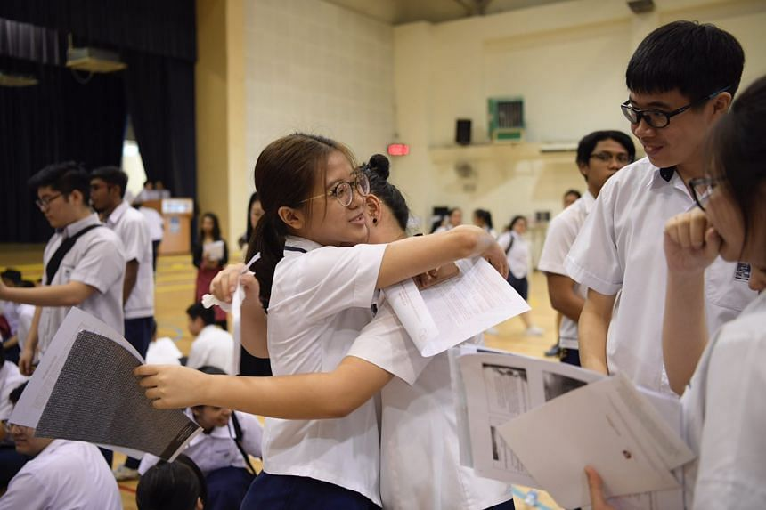 Students at Serangoon Garden Secondary School celebrate after receiving their O-Level results on Jan 11, 2017.