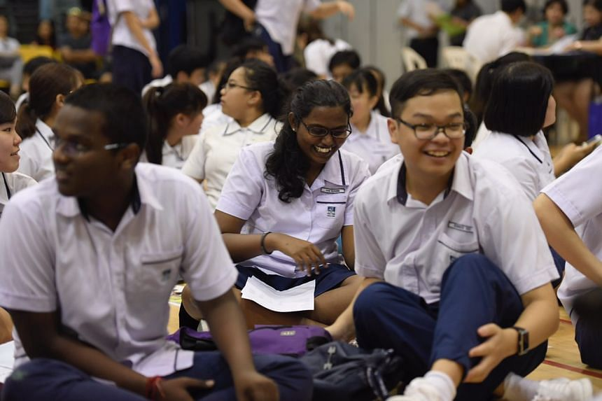 Students at Serangoon Garden Secondary School wait to receive their O-Level results on Jan 11, 2017.