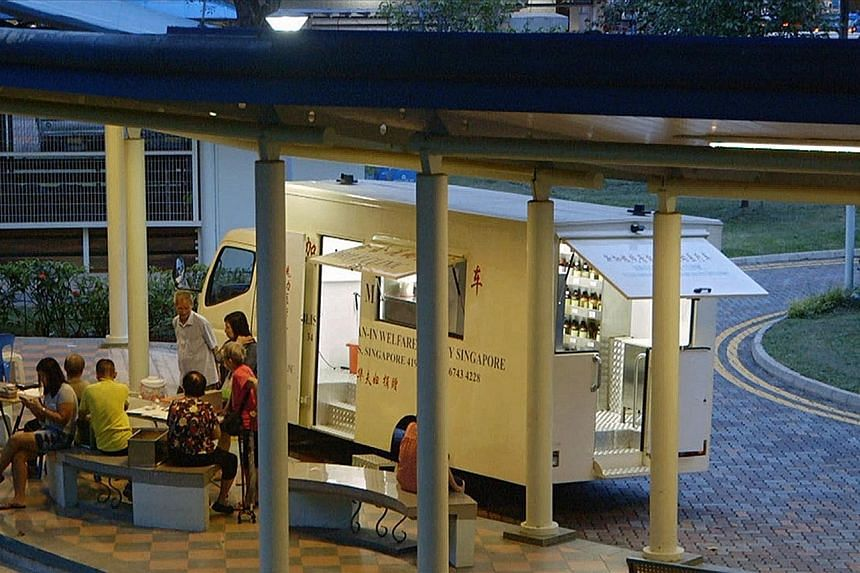 Kwan-In Welfare Society's mobile clinic in operation at Block 64 Kallang Bahru (far left). TCM physician Xie Xi Er, who has been volunteering with the organisation for more than 20 years, attending to a patient (left).