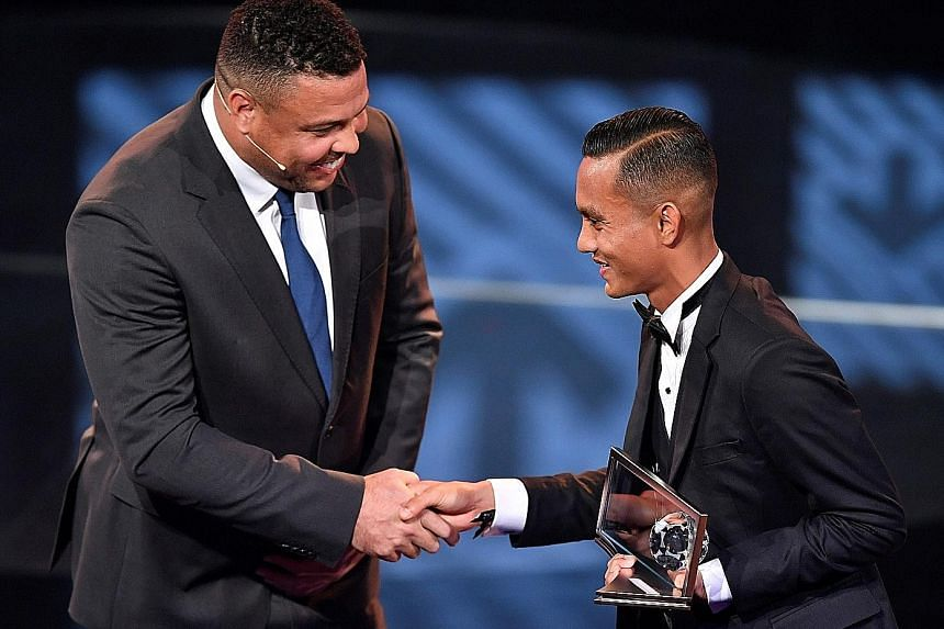 Penang FA forward Faiz Subri received the Fifa Puskas Award from Brazilian great Ronaldo at the award ceremony on Monday. His stunning free kick secured 59.46 per cent of a global vote.
