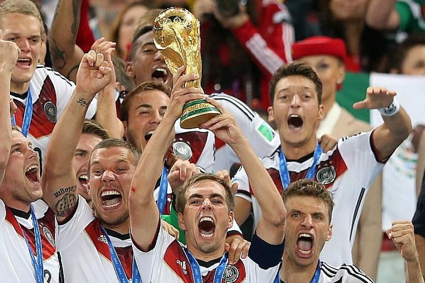Germany captain Philipp Lahm raising the World Cup trophy after they beat Argentina in the 32-team 2014 World Cup Finals.