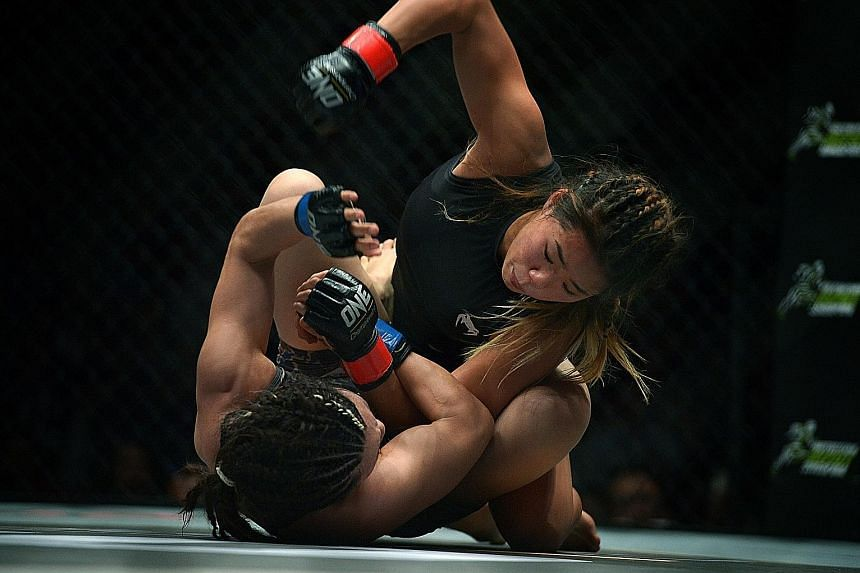 Singapore-based MMA fighter Angela Lee (on top) taking on Mei Yamaguchi of Japan in One Championship's first women's title fight. The atomweight clash last May was rated by MMAjunkie.com as one of the top five fights of 2016. Lee won by unanimous dec
