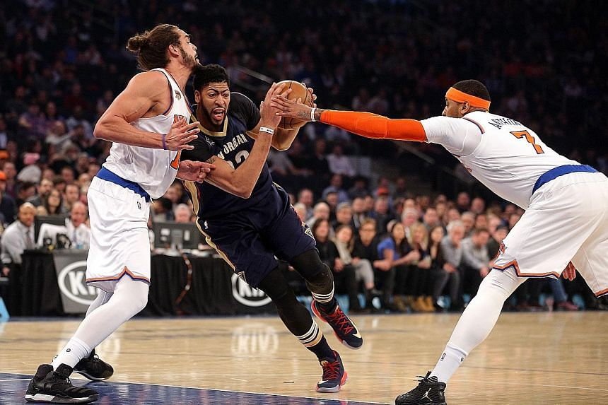 New Orleans Pelicans star Anthony Davis drives against New York Knicks centre Joakim Noah as forward Carmelo Anthony attempts to help out on defence at Madison Square Garden.