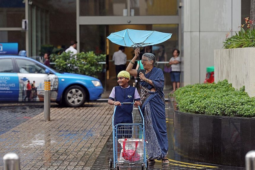 A flipped umbrella was more of a hindrance than a help, but confusion gave way to a good laugh for eight-year-old Vishal and his grandmother J. Jayalakshmi, 68. They were about to cross a road in Toa Payoh Central yesterday during an afternoon downpo