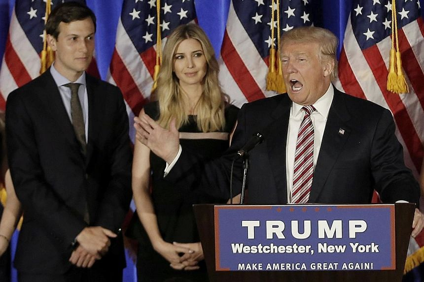 Mr Trump, with son-in-law Jared Kushner and daughter Ivanka, at a campaign event in New York last June. Mr Kushner, a New York real estate developer, will divest himself of his business assets to comply with conflict-of-interest rules, says his lawye