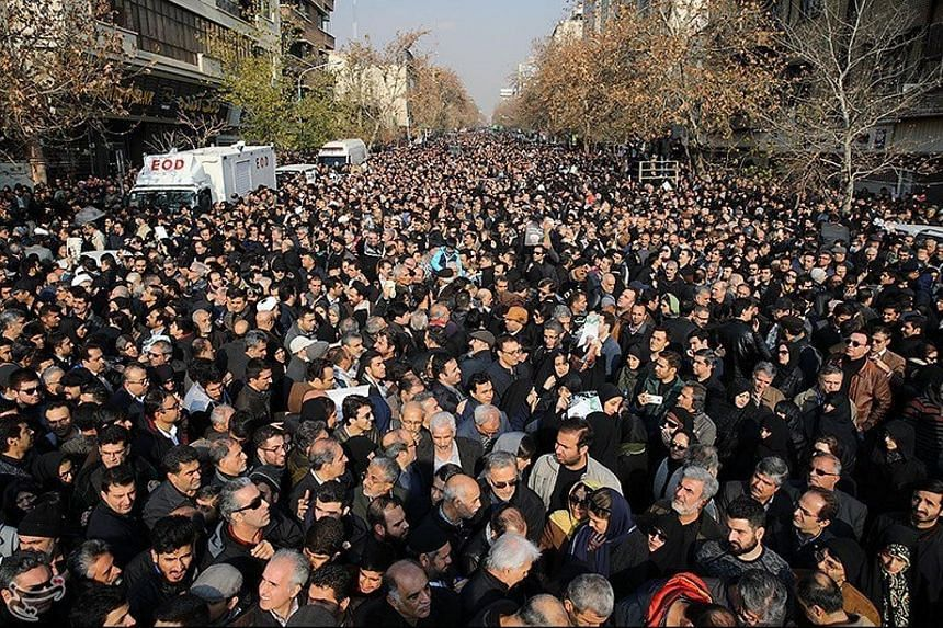 Mourners gathering during the funeral of former president Akbar Hashemi Rafsanjani in Teheran yesterday. It took more than two hours for the cortege to get to the mausoleum where Mr Rafsanjani was laid to rest.