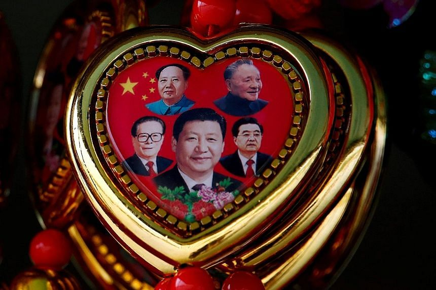 """Left: A souvenir featuring portraits of (clockwise, from centre) Chinese President Xi Jinping and former leaders Jiang Zemin, Mao Zedong, Deng Xiaoping and Hu Jintao. China may face a closing """"window of strategic opportunity"""" to secure greater influe"""