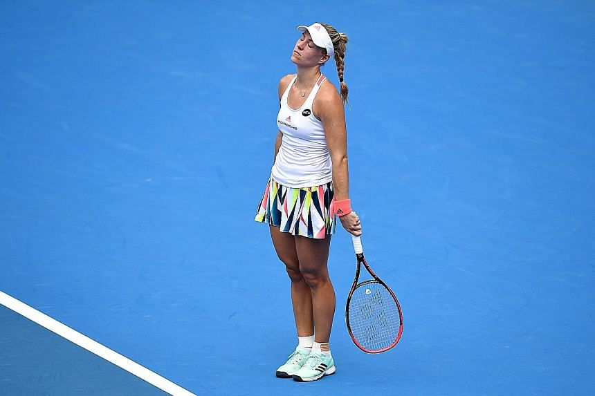 Top-ranked Angelique Kerber reacts after missing a shot against Russian Daria Kasatkina during their second match at the Sydney International tennis tournament. The German committed 41 unforced errors in the 7-6 (7-5), 6-2 loss.