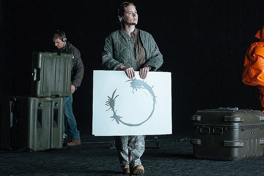 In Arrival, Amy Adams figures out that the aliens communicate using a written language of complex swirls and circular symbols known as logograms.