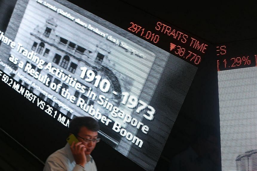 The Straits Times Index (STI) is displayed on a ticker board at the SGX Centre.