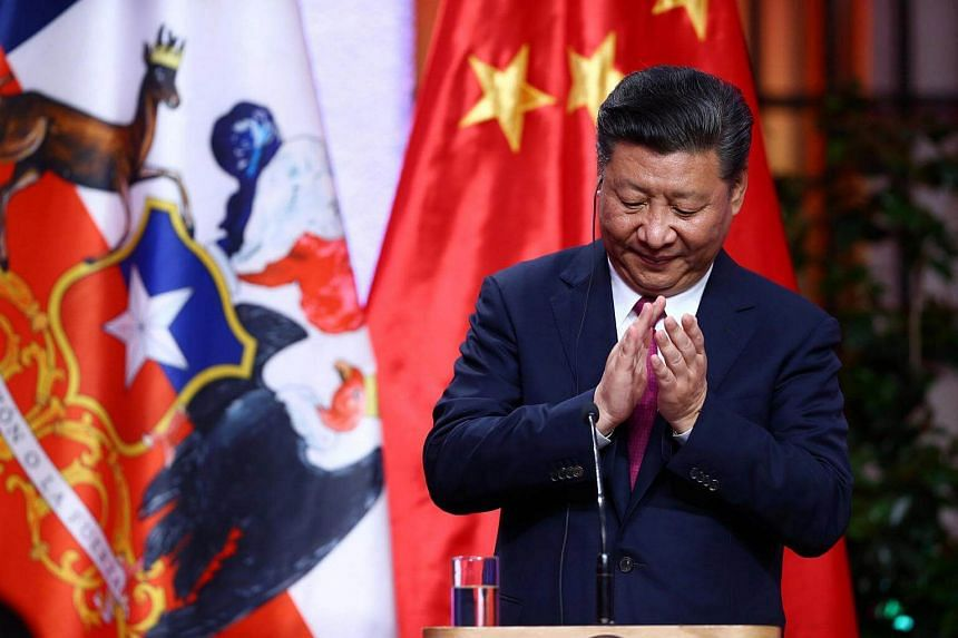 China's President Xi Jinping applauds after a signing bilateral agreements with Chile's President Michelle Bachelet (not pictured) during a meeting at the government house in Santiago, Chile.