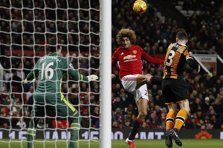 Manchester United's Marouane Fellaini scores their second goal in the EFL Cup Semi Final First Leg at Old Trafford on Jan 10, 2017.